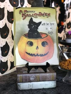 "This darling vintage kitty cat Halloween countdown was a fun way to greet guests. ""Black Cat Halloween Party Reveal"" on Halfpint Design - Halloween party ideas, kitty cat party, kids party, cat party treats"