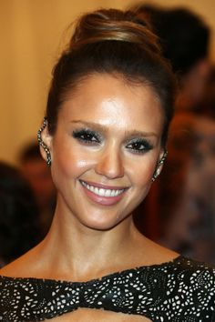 Red Carpet Beauty 2013: Met Ball, May 2013 - With her hair swept into a bun worn high on the top of her head, Jessica Alba opted for metallic smoky eyes and glossy lips.