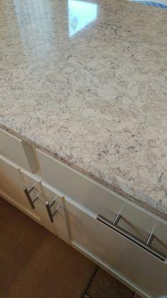 LG Aria quartz with creamy white cabinets