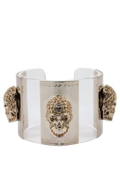 This luxurious PP bracelet comes with precious skulls covered with small crystals. Wear this piece to enrich a night-out outfit. Browse our complete collection of mens designer clothing with more from Philipp Plein. FW14-AW870567