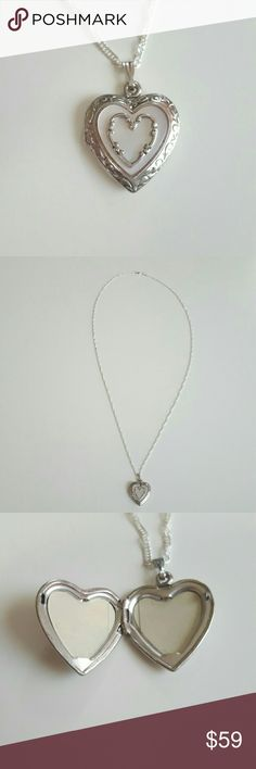 """Heart Mother of Pearl Locket Necklace This amazing vintage necklace has a sterling silver detailed heat locket pendent that has swirls on the outside of natural cut Mother of Pearl that is beautifully framed with a center heart detail. The inside has the protective plasic for the pictures and the back is stamped 925 R. Locket is 1"""" long and 3/4"""" wide on a chain that is 23"""" long. Great with your favorite shirt and jeans. Other great accessories in my closet. Vintage Jewelry Necklaces"""