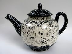For those who don't want another chair, hand painted teapots will also be auctioned!