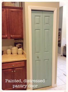Painted, distressed, and added a nicer knob to our boring, construction grade bi-fold pantry door. Used paint we had from our laundry room makeover, so the project cost less than $5.00 ... for the knob!