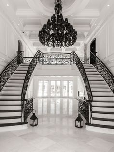 A grand double staircase with custom iron railing a. A grand double staircase with custom iron railing and marble floors be Luxury Staircase, Double Staircase, Modern Staircase, Staircase Design, Modern Entryway, Grand Staircase, Dream Home Design, My Dream Home, Home Interior Design