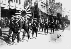 Japanese Navy Marines (SNLF) parade along Nanjing road in Shanghai, the same day as the attack on Pearl Harbor, December 7th, 1941. Note the swastika in the background, as the parade is around the corner from the German embassy. Pin by Paolo Marzioli