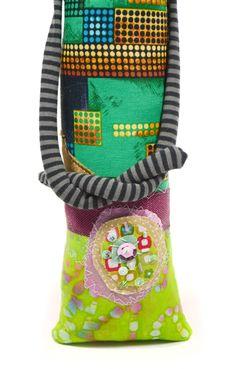 Green pinhead monster doll, front detail