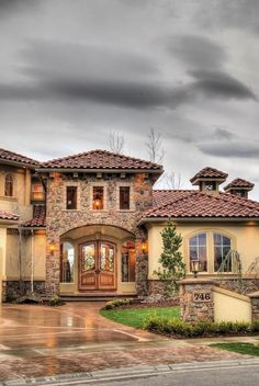 BEAUTIFUL! my house WILL have spanish style roofing!