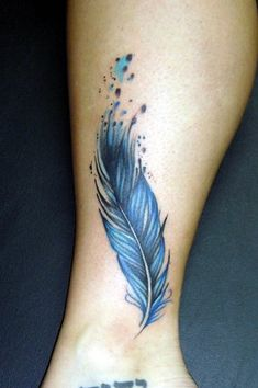 Watercolor feather tattoo by Noel Michele at Lucky 13 Tattoo in Mooresville NC.