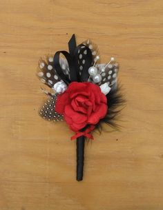 Red rose and black feather handmade grooms boutonniere on Etsy - Project Wedding