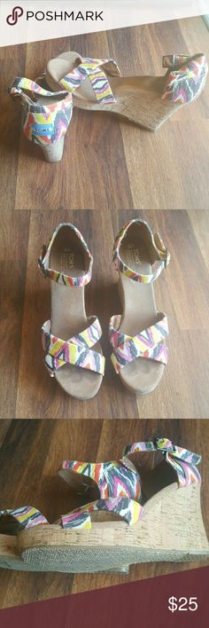 10w TOMS wedge sandals Good condition except wear where your feet go. Other than that these are pretty much perfect! TOMS Shoes Wedges