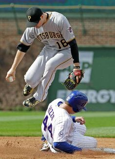 Jumping the slide -        Pittsburgh Pirates second baseman Neil Walker, top, jumps after forcing out Chicago Cub' Anthony Rizzo, bottom, at second during the third inning of a baseball game on May 16 in Chicago. Cubs' Starlin Castro was safe at first. - © Nam Y. Huh/AP Photo