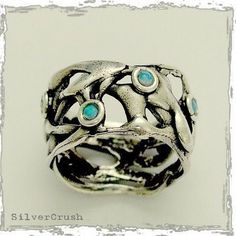 Sterling silver wide organic shaped gemstones ring with small blue opals - Fluidity.. $96.00, via Etsy.