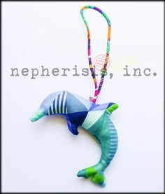 Hermes dolphin silk ornament. New condition with Hermes box & ribbon.