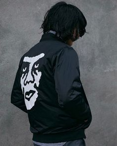 Get lightweight protection from the elements with the Creeper black satin bomber jacket from Obey that has a white logo graphic printed at the left chest and a large Andre The Giant graphic printed on the back.