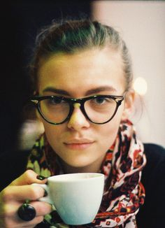 chignon with glasses and a beautiful scarf while enjoying a dleish coffee? YES please.