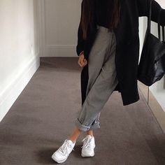 Grey or black trousers with reeboks and oversized coat