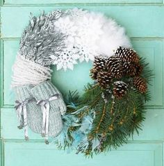 Wrap floral foam with bands of winter colors, using your favorite materials for a creative wreath.  To start, cover a 10- to 12-inch ring of floral foam with white cotton batting. Add materials you have on hand or find at crafts stores--we used snowflake ornaments, ribbon, pinecones and branches, mittens, icicle garland and silver-painted leaves and berries.