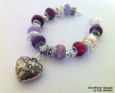 Heart Charm Bracelet Valentine's Day Gift by ClearWaterDesignsbyK, $27.67 http://clearwaterdesignsbyk.etsy.com http://clearwaterdesigns.info This Red & Purple Heart Charm Bracelet is the perfect Valentine's Day Gift! This European Style Charm Bracelet is is packed full with gorgeous High End European Lampwork Beads in Pink, Purple & Red Shades. The bracelet is a 925 Sterling Silver Snake Chain with an easy snap on clasp.