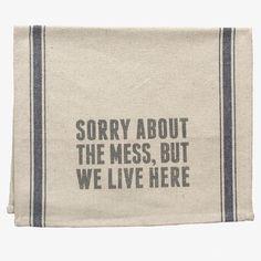 'We Live Here' Tea Towel. Yup.