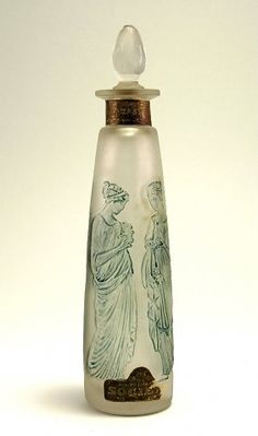 c.1920's Carlova Narcisse perfume bottle and stopper in frosted glass, blue patina, partial label. 7 3/4 in. Est. $100 – $200
