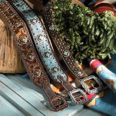 Double J ladies fashion belts in brown and turquoise.