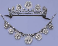 Floral Diamond Necklace/Tiara Designed as seven graduated old-cut diamond flowerheads suspended from the diamond foliate line to the knife-edge and collet backchain, with fittings for a tiara, brooches and earrings, mounted in silver and gold, circa 1880, 44.6 cm. long, in original Carrington & Co. Ltd. tan leather fitted case.