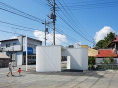 kubo tsushima places minimalist public toilet in a japanese parking lot