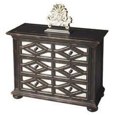 """Handcrafted chest with mirror inlays.  Product: ChestConstruction Material: Gemelina woodColor: Dark brownFeatures:  Moderate distressingThree large drawers Dimensions: 32"""" H x 40"""" W x 18"""" DCleaning and Care: Wipe with a soft dry or slightly dampened cloth"""