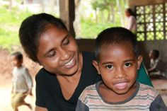 """""""This is my beautiful #mum. I love her because she cooks rice and porridge for me,"""" 5-year-old Libanio says."""