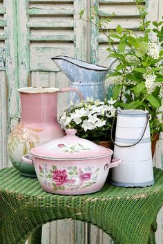 Shabby Chic Green Wicker Table with Colorful Enamelware Containers and Flowers