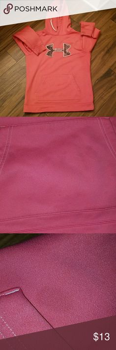 A peachy pink colored UA hoodie No rips but has a handful a small blotches to front pocket they are hard to see when worn. Pic 2 tries to show them they look purple in pic. Cuffs are stained up some as well see pic 4/5. Rolling up the sleeves once  would  hide that. Back of hoodie there are a few light marks. Overall a great pullover. Still looks good one and is from a smoke free home Under Armour Tops Sweatshirts & Hoodies