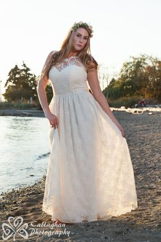 Love all the lace in this #plussizebridal gown!