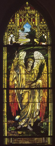 The West Angel Window. Because of their exposures and how they caught the sun, they are referred to as the morning and evening angels. Mrs. D. P. Hadden gave both windows, on the west in memory of her mother, Mrs. Mary Ann Hudspeth Boyd, and on the east in memory of the Rev. Granville Allison, first rector of Grace Church. The Angel Windows are two of seven Grace-St. Luke's windows originally installed in Grace Church.