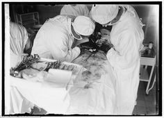 Armed with an array of basic medical tools, these surgeons can be seen cutting into the patient's stomach mid-surgery during what appears to be an abdominal procedure. Nowadays surgeons have access to much more than just forceps to make incisions Medical Photography, Vintage Medical, Medical History, Surgery, 19th Century, Chill, The Cure, Pin Up, Medicine