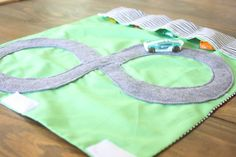 Kids Activities: 10 ways to keep little boys busy.  I love this roll-up car track.  I will be making a monster truck track for someone I know!
