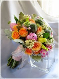 """""""Hand-tied bouquet with pink tulips and hydrangea, suitable for spring weddings..."""", explains Helen Chang of Misty Garden"""