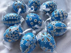 Blue colored decorated eggs with hanging ribbons Diy And Crafts, Arts And Crafts, Carved Eggs, Egg Tree, Easter Egg Designs, Ukrainian Easter Eggs, Egg Decorating, Egg Shells, Easter Crafts