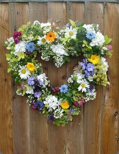 Lovely heart wreath with summer flowers