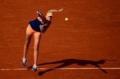 Kristina Mladenovic Photos Photos - Kristina Mladenovic of France serves during her women's singles match against Andrea Petkovic of Germany on day seven of the French Open at Roland Garros on May 31, 2014 in Paris, France. - 2014 French Open - Day Seven
