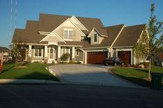 Multiple roof lines, garage on left side, usable space above garage.