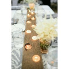 Recycle an old piece of wood and use it to hold candles as a cute and simple center piece! #diy #spring #picnic