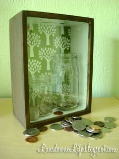 This idea was inspired by a few different things. This idea to turn a shadowbox frame into a bank. I remember some charity coin donation box on the counter of a Dairy Queen where the goal was to land a coin in a shot glass. Unimportant detail: it wa Coin Jar, Change Jar, Diy Shadow Box, Nonprofit Fundraising, Money Bank, Diy Box, Diy Stuffed Animals, Charity, Diy Projects