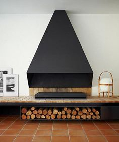 Natural Wood Interiors :: Fireplace, Wood Platform, Black Geometrical Fireplace Vent, Chopped Wood Storage.