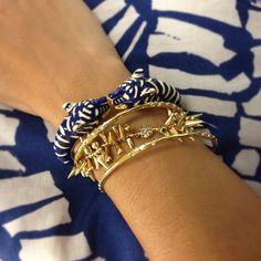 Blue and gold armparty worn with a bold, tribal-inspired print.