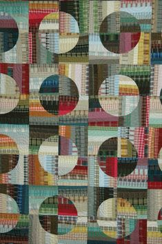 An amazing quilt not only using curved pieces but also a very impressive collection of check shirts! #quilt #quilting #patchwork #sewing #fabric #plaid