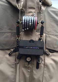 A new system we are making that allows you to add a fly box to your Lanyard and fully adjustable by attaching your fly box clips to the round cord locks you see on each side above the fly patches you can position right where you want it, and reverse the f Fly Fishing Lanyard, Fly Fishing Kit, Fishing Knots, Fishing Guide, Tacky Day, Trout Unlimited, Shirt Clips, Fly Rods, Team Usa