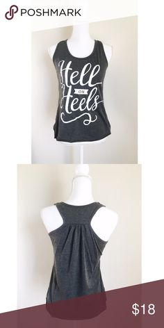 """Hell On Heels Tank NEW! """"Hell on heels"""", it pretty much describes itself and possibly yourself. It has a racer-back detail on the back and an unfinished hem to make casual enough with jeans. It be worn as a warning if needed ⚜ Size small Tops Tank Tops"""
