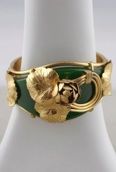 Late 1940s Bakelite bracelet green hinged bangle brass flowers from Viva Vintage Clothing (SOLD)