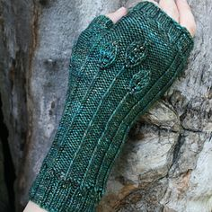 """These elegant mitts are embossed with little leaves and embellished with beads. Special details include pretty transitions from the rib borders to the mitt itself…and don't miss the little leaf """"growing"""" up the thumb."""