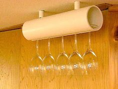 Wine glass hanger using pvc pipe. I'd add some fabric or pretty paper with Mod Podge, or at least some more color, but I like it!
